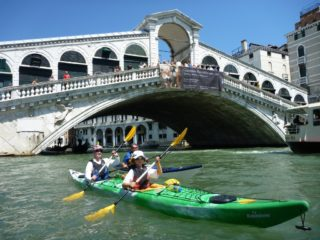 Venice - Rialto - father and child in green double kayak