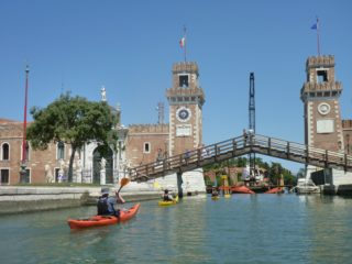 Kayaks paddling towards the Arsenale (press photo)