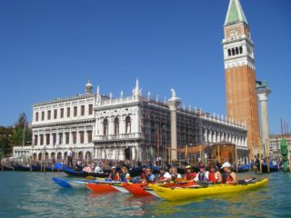 Group of kayaks posing in front of San Marco (press photo)