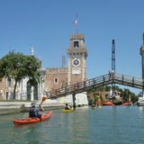 Kayaks paddling towards the Arsenale